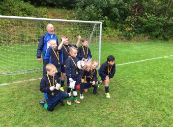 U9 Football Team Wins the Plate