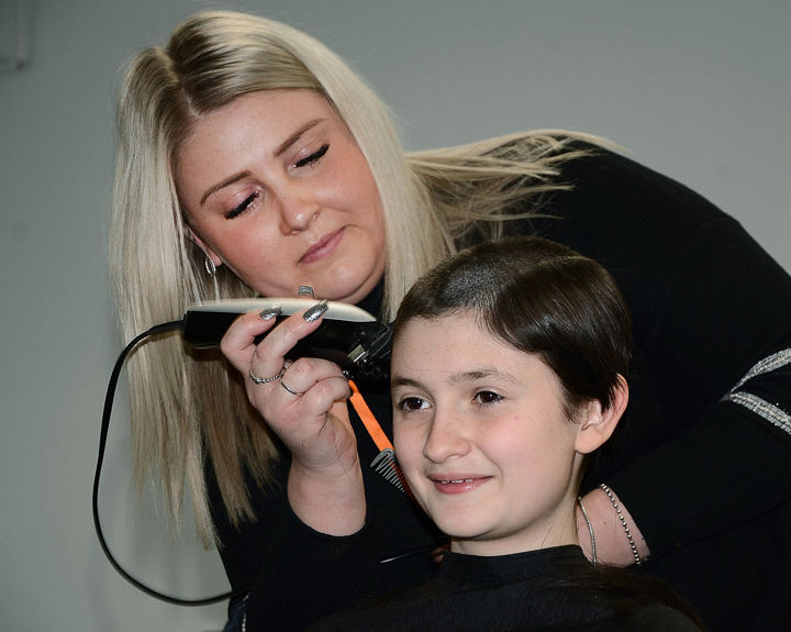 Teen girl shaves head for charity