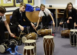 Students inspired by professional Indian drumming