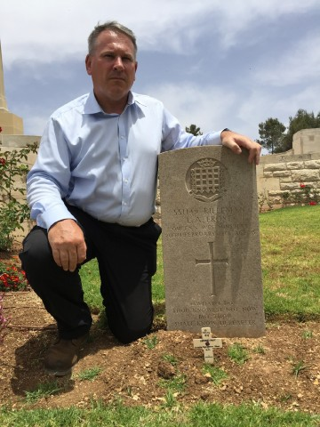 Colonel Richard Kemp CBE placing a commemorative poppy on the grave of an OC killed in WW1 - Leonard Frost - who was killed in action on 22.19.18 aged just 25