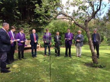 OCs, staff members and pupils honouring WW1 fallen OCs at the CRGS Garden of Remembrance in May 2015