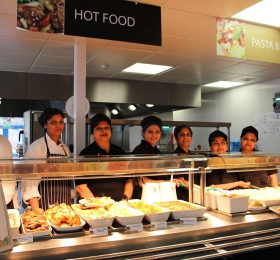 dining hall staff serving