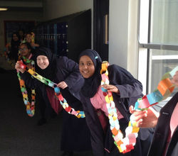Girls Make Giant Paper Chain For World Pi Day