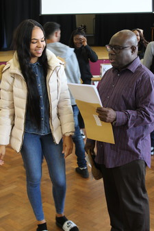 Student showing teacher her amazing gcse results