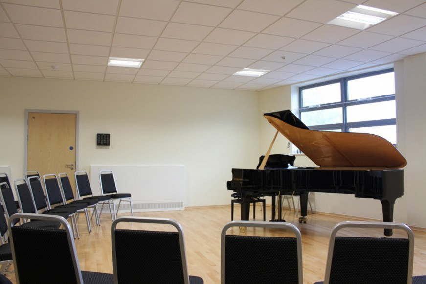 Recital room enlarged