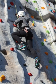 Climbing wall - girl climbing