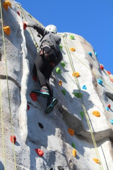 Climbing wall - girl climbing to top