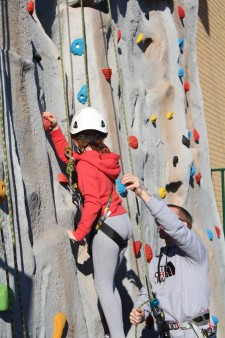 Climbing wall - girl being instructed