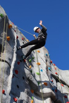 Climbing wall - girl waving