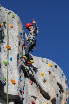 Climbing wall - boy waving
