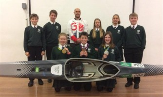 Olympic Gold Medal winner talks to PE students