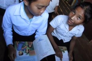 Girls practice reading at Kiri Bah Ler